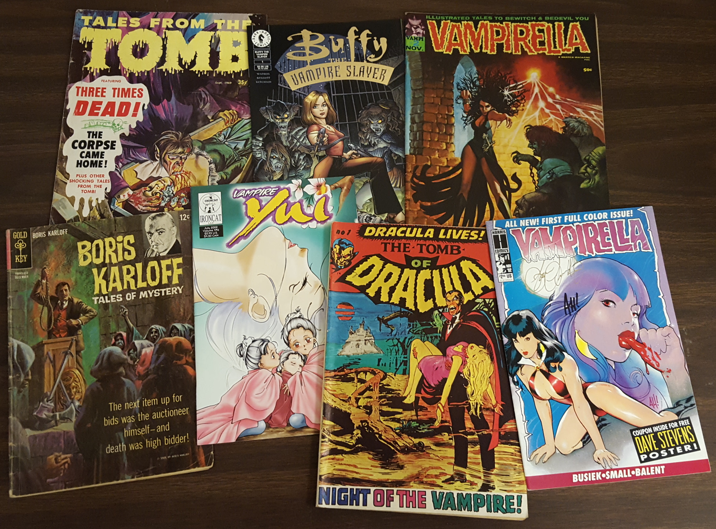 Image 5: A sampling of signed titles from the J. Gordon Melton Vampire Collection, including Vampirella, Tomb of Dracula, and Buffy the Vampire Slayer.